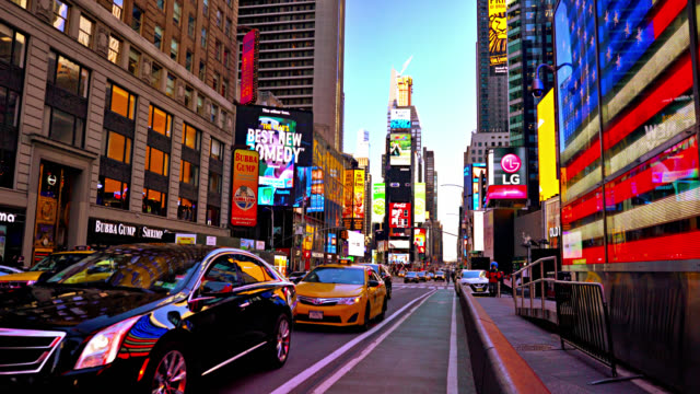 times square and american flag - times square manhattan stock videos & royalty-free footage