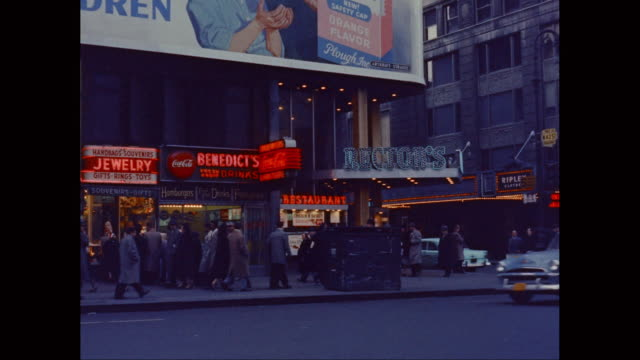 WS PAN Times Square and Broadway, traffic and people, theater marquees / New York State, United States