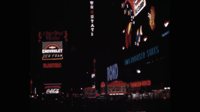 1946 times square at night - commercial signs on buildings with traffic moving on street, new york city, new york state, usa - colour image stock videos & royalty-free footage