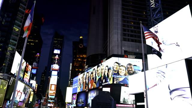 stockvideo's en b-roll-footage met times square at night, illuminated billboards - digital signage