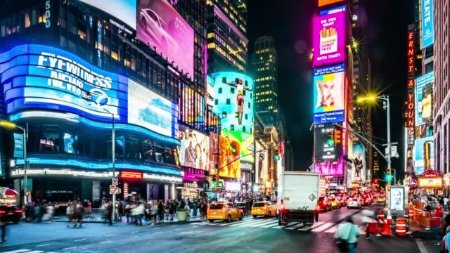 t/l ws pan times square at night / new york city, usa - international landmark stock videos & royalty-free footage