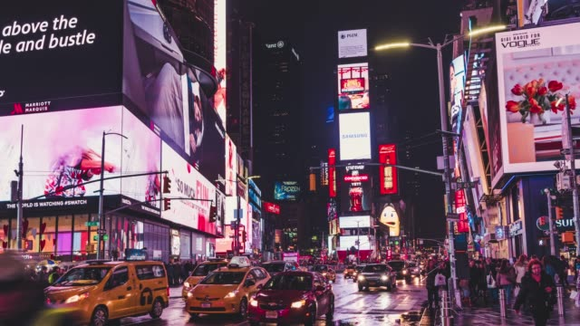 t/l pan times square at rainy night with famous nyc yellow taxis - yellow taxi stock videos and b-roll footage