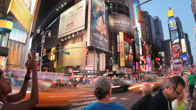 t/l times square at sunset - electronic billboard stock videos and b-roll footage