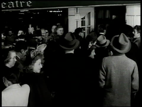 times square broadway people in coats crowded in front of theatre people in formal evening attire top hats gowns entering theatre crowd of people... - 1949 stock videos & royalty-free footage