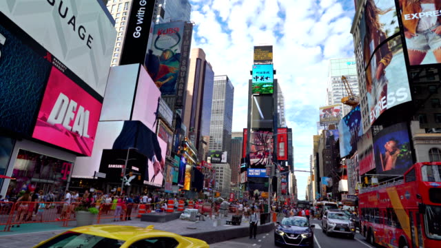 times square, clouds in the morning sky, billboards - ミッドタウンマンハッタン点の映像素材/bロール