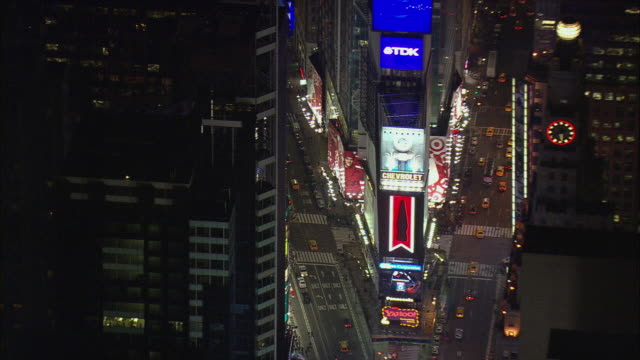 aerial times square illuminated at night / new york city, new york, usa - skyscraper stock videos & royalty-free footage