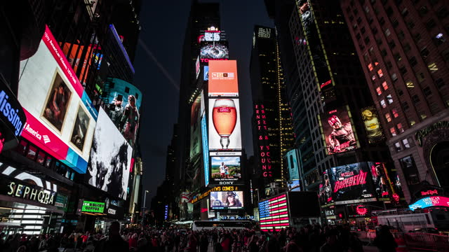 times square in new york city at night - usa - commercial sign stock videos & royalty-free footage