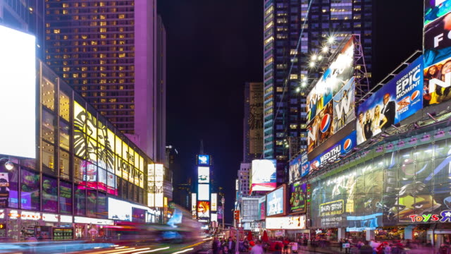 times square lit up at night - time lapse - large scale screen stock videos & royalty-free footage