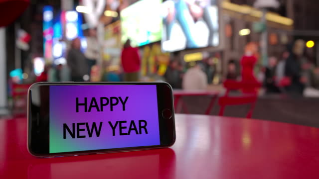 Times Square New York smartphone celebration crowd happy new year