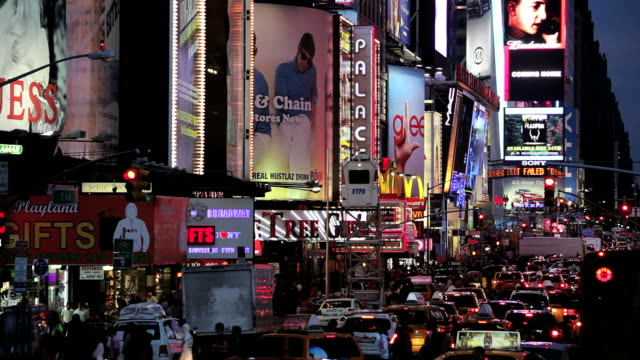 times square new york with billboards neon lights and illuminated signs, manhattan, north america, usa - ブロードウェイ点の映像素材/bロール