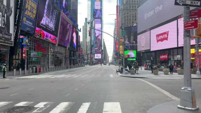 times square stands mostly empty as much of the city is void of cars and pedestrians over fears of spreading the coronavirus on march 22 2020 in new... - times square manhattan bildbanksvideor och videomaterial från bakom kulisserna
