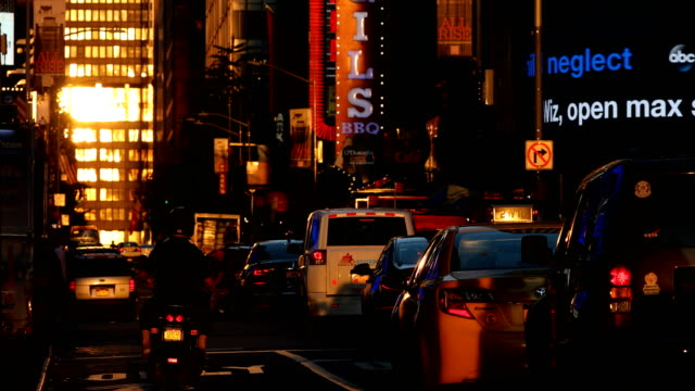 times square sunset traffic - city street sign stock videos and b-roll footage