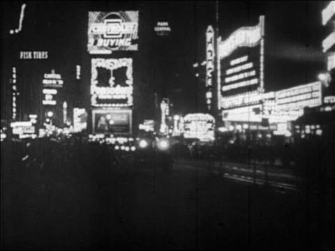 b/w 1928 times square with lights + traffic at night / nyc / newsreel - 1928 stock videos & royalty-free footage