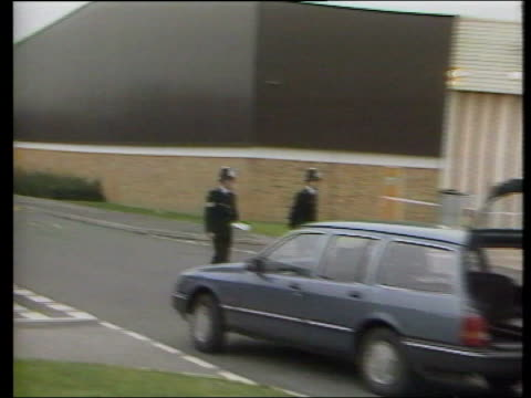 stockvideo's en b-roll-footage met john palmer convicted; lib england: heathrow police officers along outside brinks mat warehouse from where gold was stolen pull out fingerprint... - itv