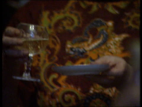 timisoara new year celebrations romania timisoara man popping champagne open pull out family around table celebrating cms champagne poured ms member... - romania stock videos & royalty-free footage