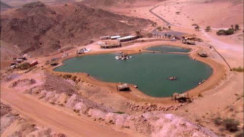 aerial timna lake in negev desert, israel - アラバ砂漠点の映像素材/bロール