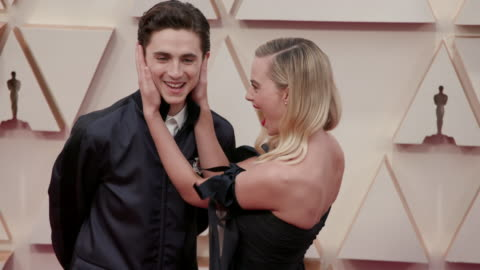 timothée chalamet and margot robbie at the 92nd annual academy awards at dolby theatre on february 09, 2020 in hollywood, california. - academy of motion picture arts and sciences stock videos & royalty-free footage