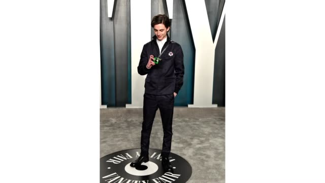 timothée chalamet attends the 2020 vanity fair oscar party hosted by radhika jones at wallis annenberg center for the performing arts on february 09,... - vanity fair oscar party stock videos & royalty-free footage