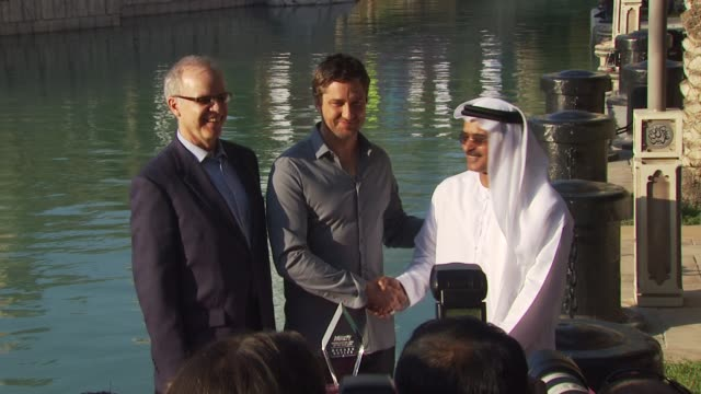 Timothy M Gray Gerard Butler DIFF Chairman Abdulhamid Juma at the Gerard Butler Photocall and Press Conference DIFF 2009 at Dubai