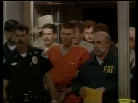 timothy mcveigh led out of building by police gv execution room showing electric chair in centre - electric chair stock videos and b-roll footage