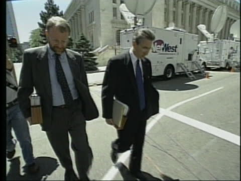 timothy mcveigh's attorneys robert nigh and nathan chambers walk down a street. - timothy mcveigh stock videos & royalty-free footage