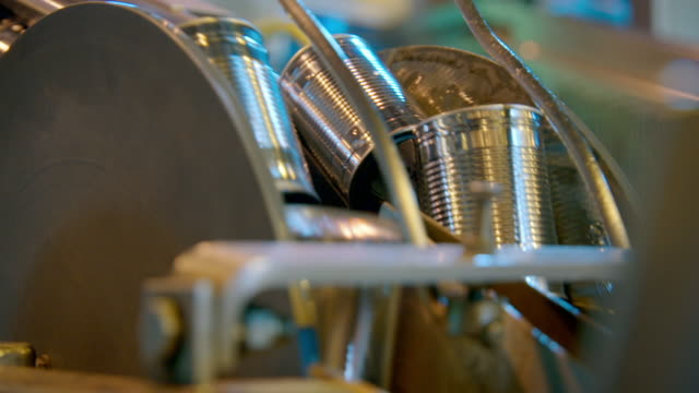 tin cans speed along factory machinery - railings stock videos & royalty-free footage