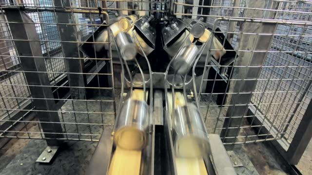 tin cans travel along chutes in a factory - インスタント食品点の映像素材/bロール