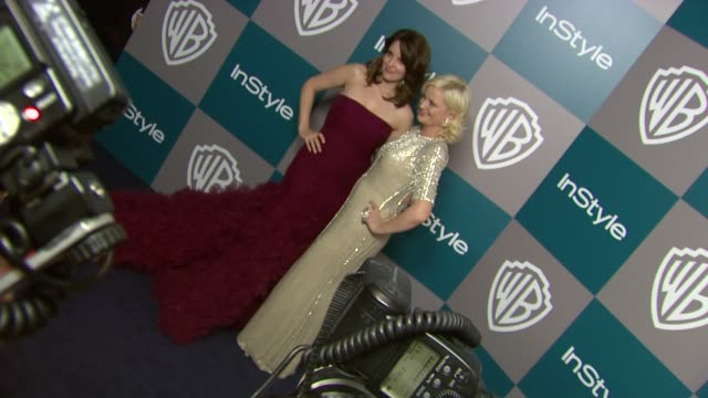 Tina Fey and Amy Poehler at the 13th Annual Warner Bros And InStyle Golden Globe AfterParty at The Beverly Hilton Hotel on 1/15/12 in Los Angeles CA