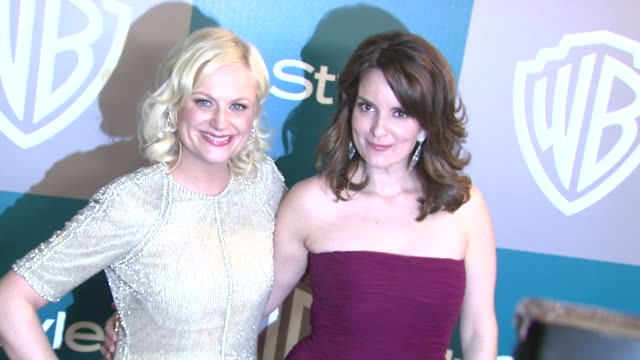 tina fey and amy poehler at the 13th annual warner bros. and instyle golden globe after-party at the beverly hilton hotel on 1/15/12 in los angeles,... - エイミー・ポーラー点の映像素材/bロール