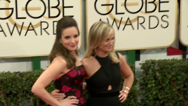 Tina Fey and Amy Poehler at the 71st Annual Golden Globe Awards Arrivals at The Beverly Hilton Hotel on in Beverly Hills California