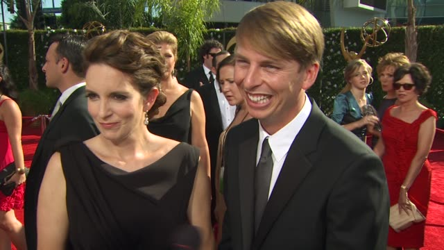 vídeos y material grabado en eventos de stock de tina fey jack mcbrayer on their nominations experiencing the emmys how long it took to get ready who they're wearing at the 61st annual primetime... - jack mcbrayer