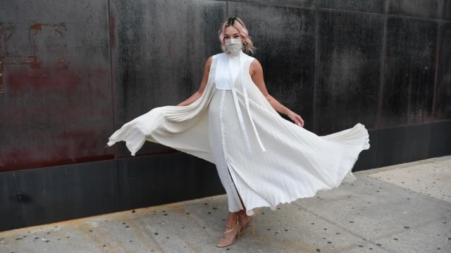 tina leung is seen in a white dress and sheer shoes outside of new york fashion week the shows at spring studios on september 13 2020 in new york city - gif stock videos & royalty-free footage