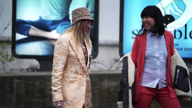 Tina Leung wears a Prada geometric pattern hat a blazer jacket Susanna Lau wears a pink blazer jacket a blue shirt an aviator jacket outside Acne...