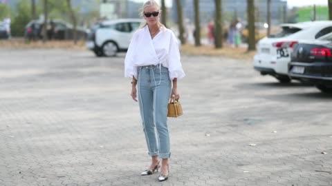 tine andrea wearing white blouse, denim jeans is seen outside holzweiler during the copenhagen fashion week spring/summer 2019 on august 7, 2018 in... - skjorta bildbanksvideor och videomaterial från bakom kulisserna