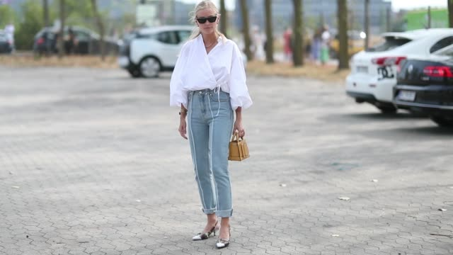 tine andrea wearing white blouse denim jeans is seen outside holzweiler during the copenhagen fashion week spring/summer 2019 on august 7 2018 in... - jeans bildbanksvideor och videomaterial från bakom kulisserna