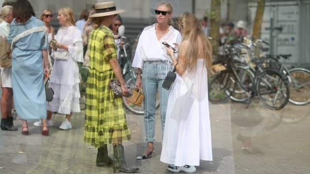 stockvideo's en b-roll-footage met tine andrea wearing white blouse denim jeans is seen outside holzweiler during the copenhagen fashion week spring/summer 2019 on august 7 2018 in... - blouse