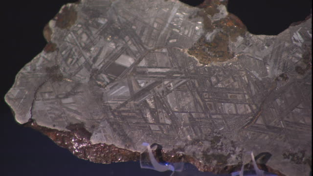 tiny grooves mark the surface of a meteorite on display. - payson stock videos & royalty-free footage