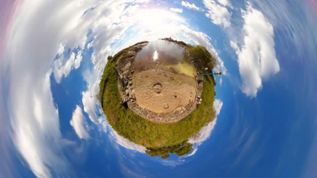 tiny planet helsinki suomenlinna beach - 360° - spoonfilm stock-videos und b-roll-filmmaterial