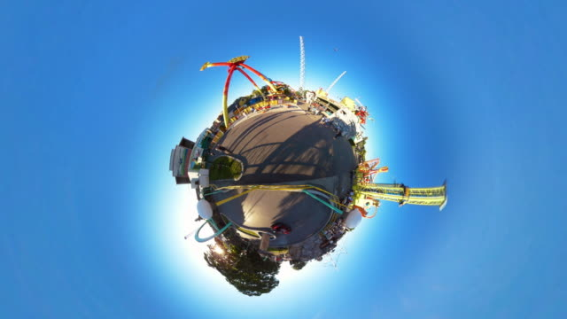 tiny planet prater in vienna with amusement park rides - 360° time lapse - prater park stock videos & royalty-free footage