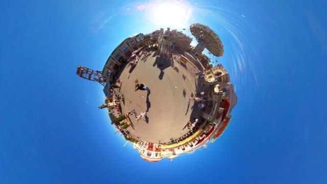 tiny planet prater in vienna with train passing through - 360° time lapse - prater park stock videos & royalty-free footage