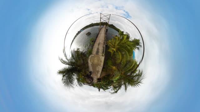 tiny planet suspension bridge on tropical island - 360° time lapse - spoonfilm stock-videos und b-roll-filmmaterial