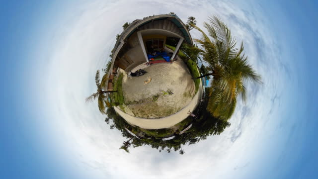 tiny planet tropical island local house - 360° time lapse - 360 video stock videos & royalty-free footage
