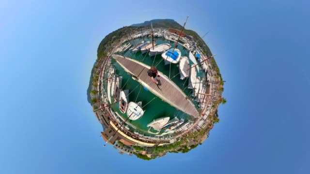 tiny planet view of sailboat moorings in the harbor - marina from port de soller  - balearic islands majorca / spain - yacht stock videos & royalty-free footage