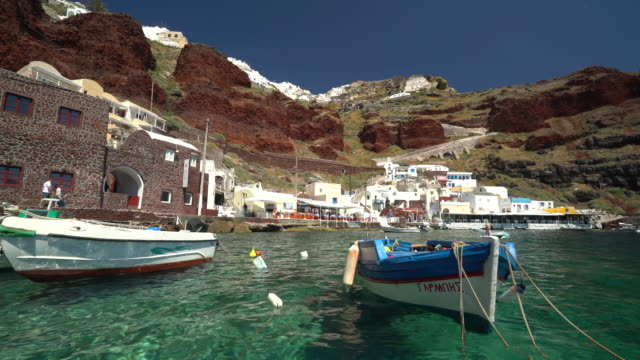 tiny port of oia santorini island - insel santorin stock-videos und b-roll-filmmaterial