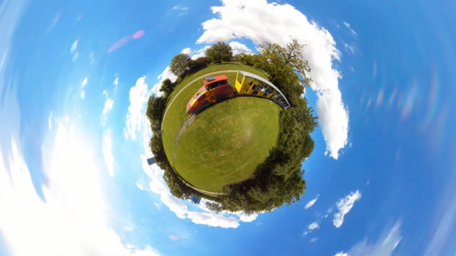 tiny train passing on tiny planet vienna  - 360° time lapse - 小さい点の映像素材/bロール