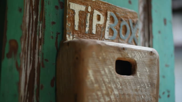 tip box at the artist house. - gratuity stock videos & royalty-free footage