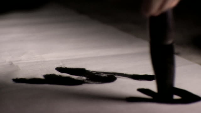 CU Tip of brush writing Chinese calligraphy in black ink on rice paper, Changsha, Hunan, China