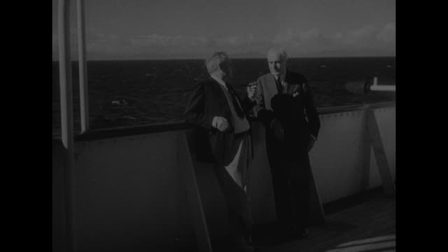 tip of ellis island with nyc skyline in bg / ms two immigrants in silhouette looking through wire grating at skyline // at sea alf landon holding... - cordell hull stock videos and b-roll footage