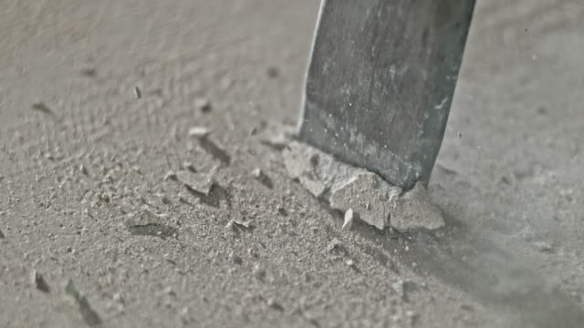 slo mo ld tip of the chisel striking the concrete and breaking it - chisel stock videos and b-roll footage