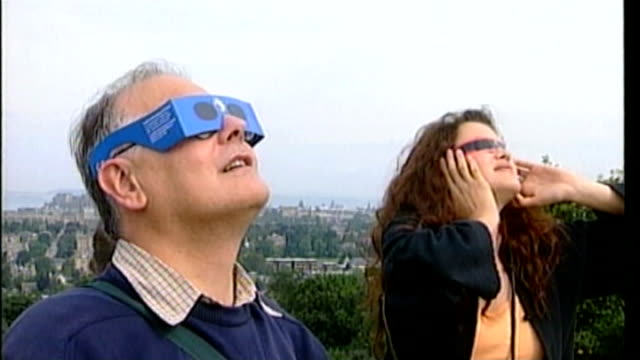 tips on how to view solar eclipse bsp110899010 / people wearing eclipse glasses and looking up to sky people next to telescope man wearing solar... - solar eclipse glasses stock videos and b-roll footage